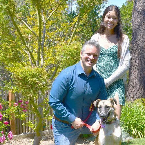 Charles with his daughter, Sophia, and rescue dog, Annie.